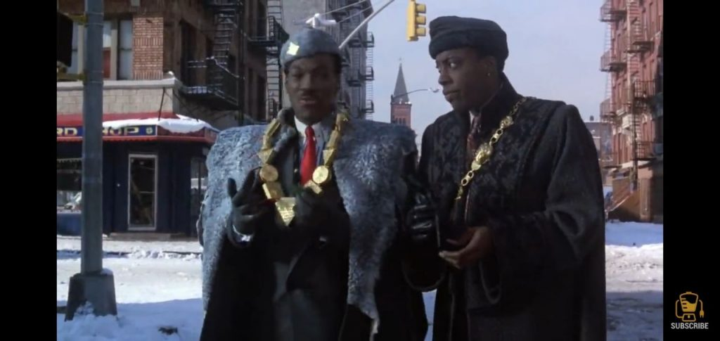 Murphy (as King Akeem Joffer) with Hall (Semmi) in Coming to America 2