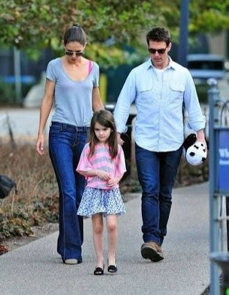 Tom Cruise with his biological child, Suri, and ex-wife Kattie